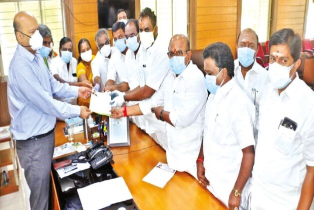 AIADMK MLAs miffed with Coimbatore collector for receiving petition while remaining seated.